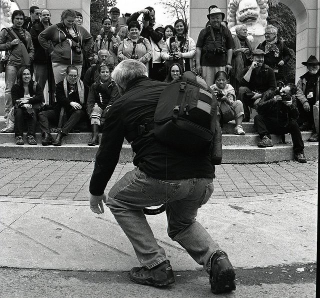 A man entertaining a crowd on the street
