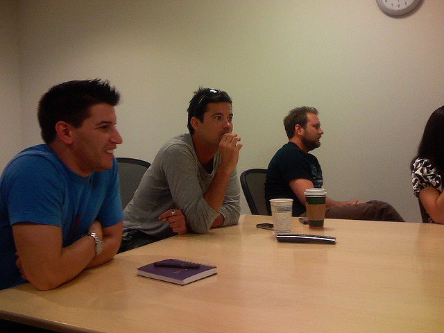 A group of men listening during a meeting